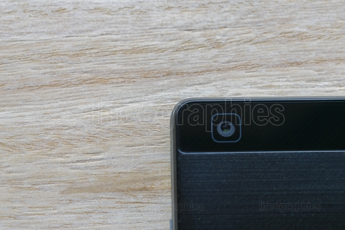 Black smart phone digital camera close up on wood background