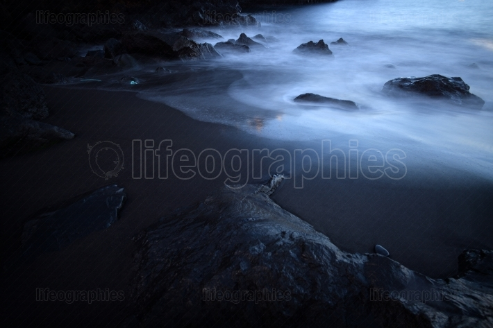 Black volcanic stones and sand at the eastern coast of tenerife,