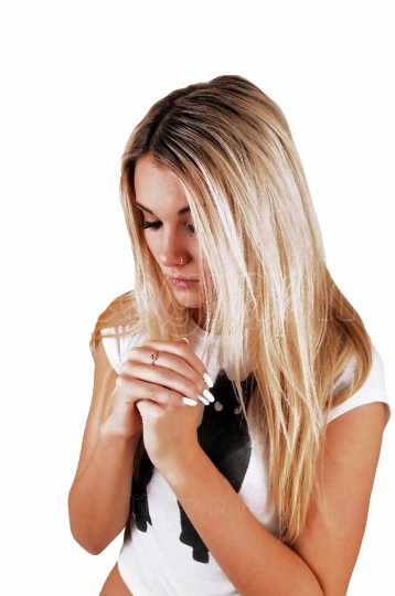 Blond girl praying