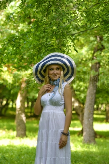 Blond lady with big summer hat
