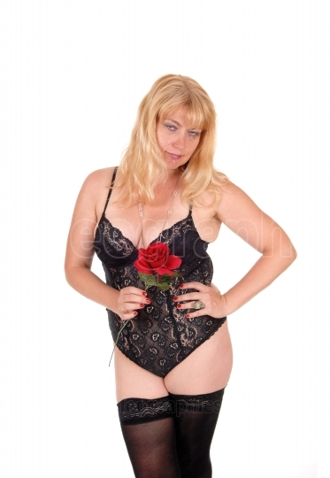 Blond woman in lingerie with red rose.