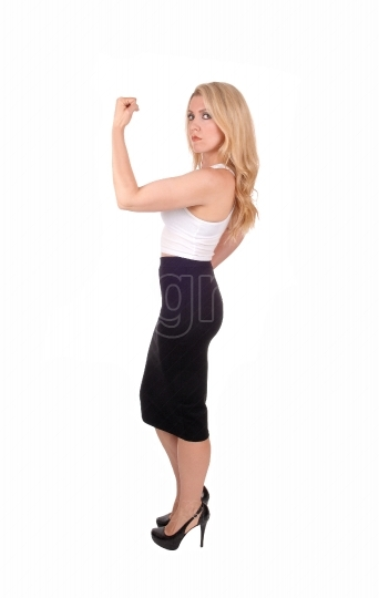 Blond woman showing her muscles.