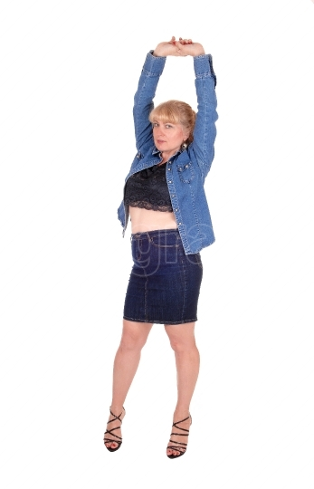 Blond woman stretching arms.