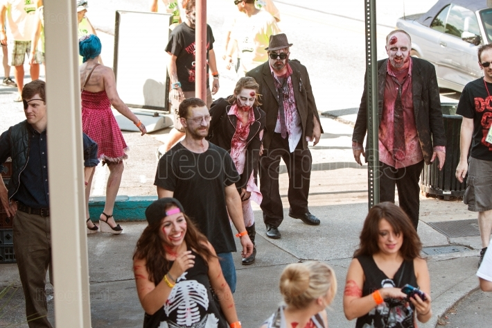 Bloody zombies stagger to bars in atlanta pub crawl