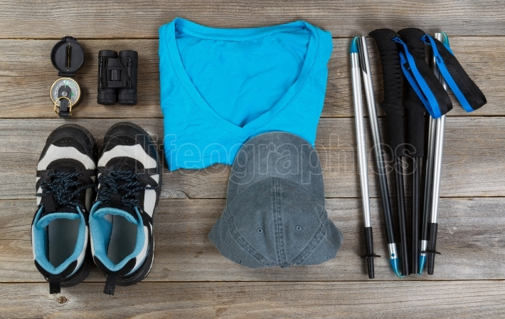 Blue color coordinated outdoor walking accessories on rustic woo