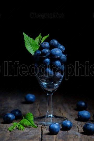 Blueberries in small glass