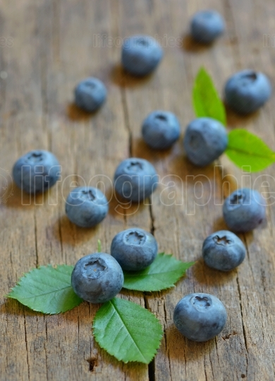 Blueberries on a  wooden background