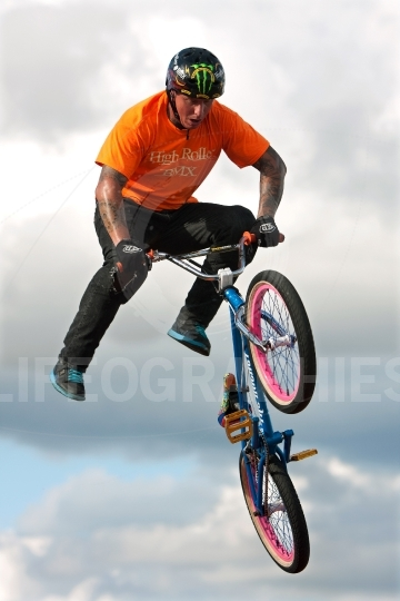 Bmx rider executes midair stunt at georgia state fair