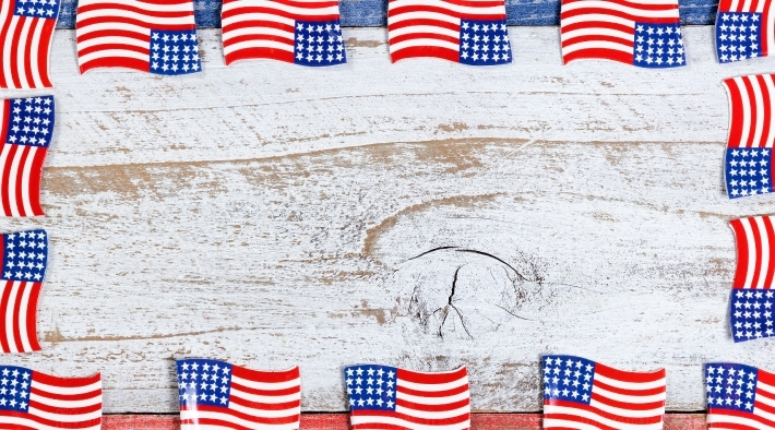 Border of small USA flags on rustic boards with national colors