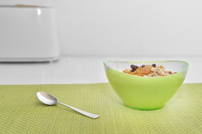 Bowl of muesli with honey