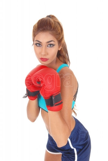 Boxing woman in closeup.