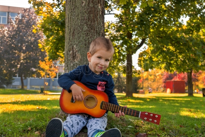 Boy holding guitar