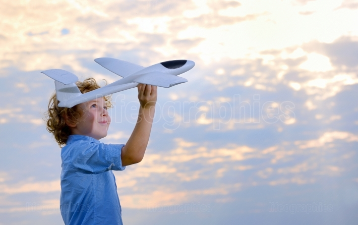 Boy throwing airplane