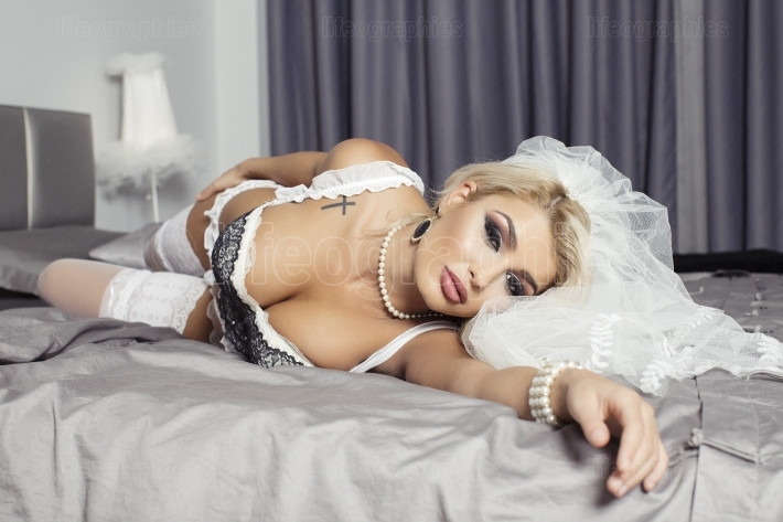 Bridal woman on the bed