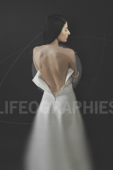 Bride with open back wedding dress