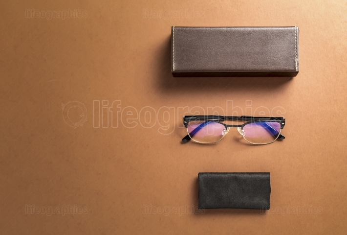 Brown eyeglasses, eyewear frame,fabric and copy space for text o