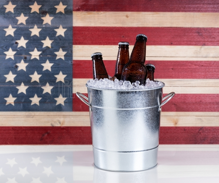 Bucket of ice cold beer with USA flag in background