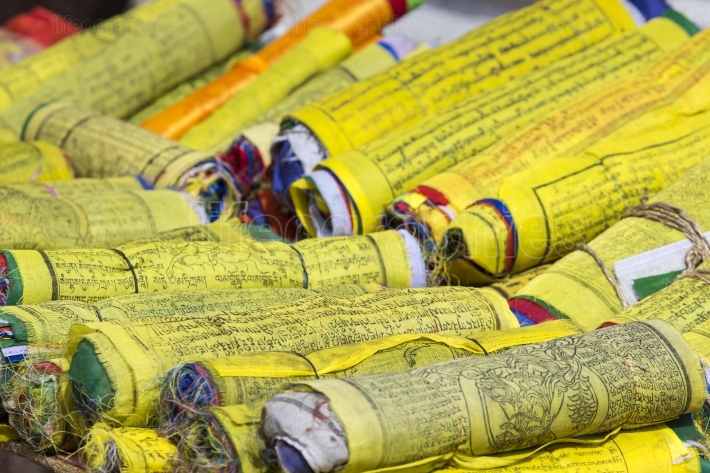 Buddhist Tibetan prayer flags rolled into a roll, Kathmandu, Nep