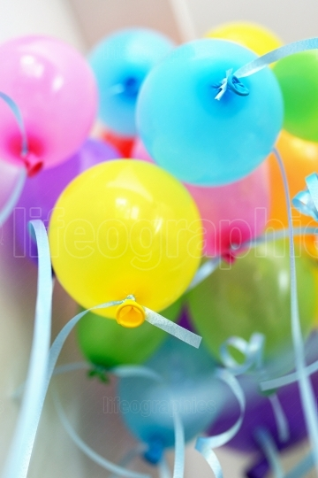 Bunch of floating colored balloons and strings