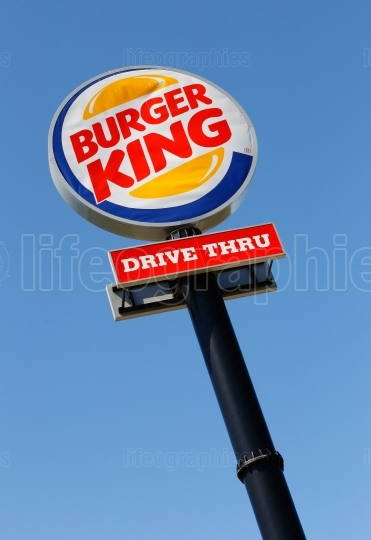 Burger King Drive in road sign against blue sky
