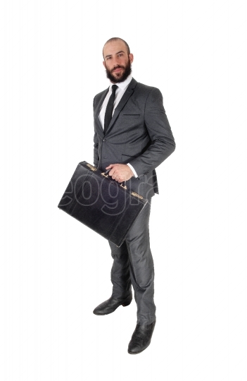 Business man holding his briefcase, standing