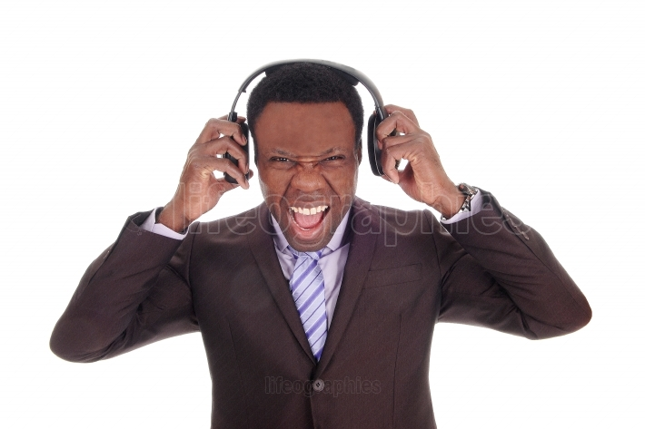 Business man listening to noisy music
