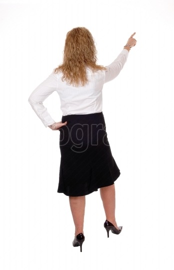 Business woman pointing up.