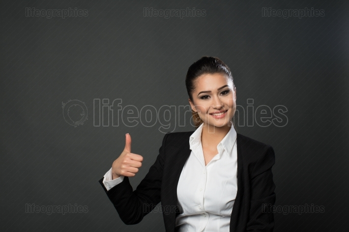 Business woman showing ok