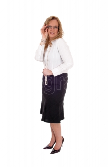 Business woman standing smiling..