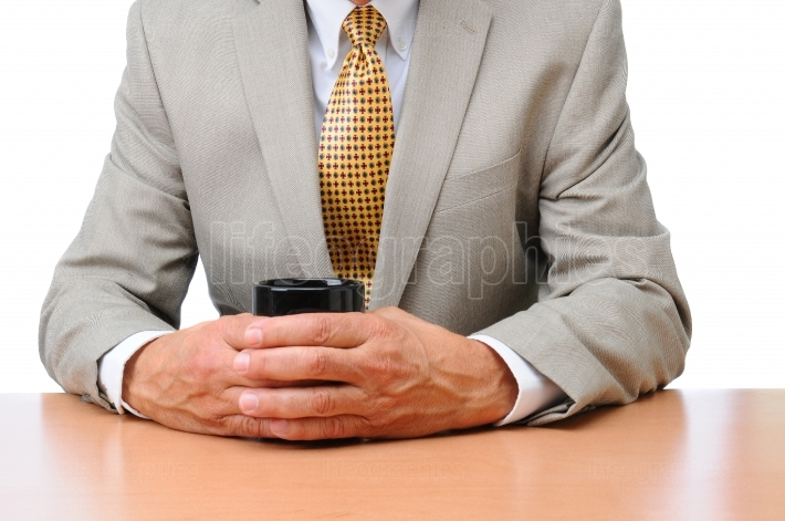 Businessman at Desk with Coffee Cup