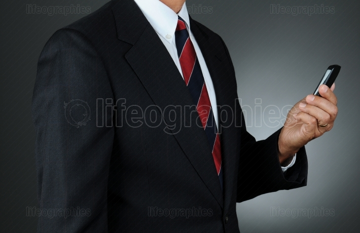Businessman Checking Cell Phone