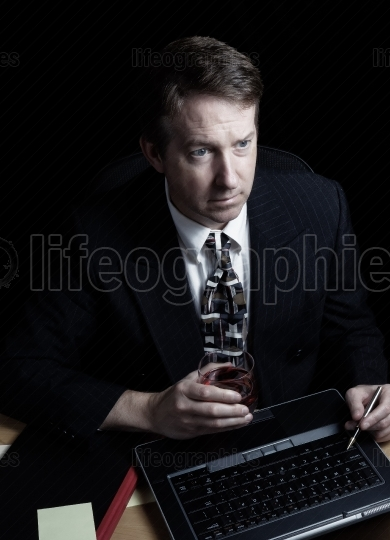Businessman double checking data late at night