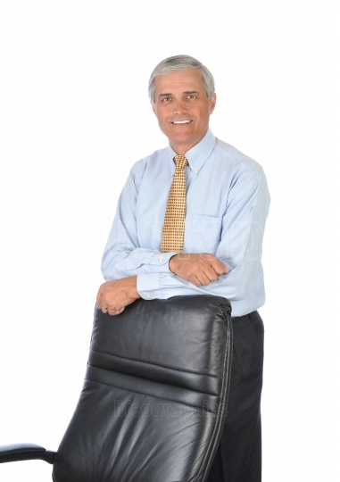 Businessman Leaning on Back of His Chair