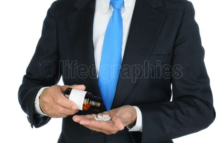 Businessman Pouring Pills into His Hand
