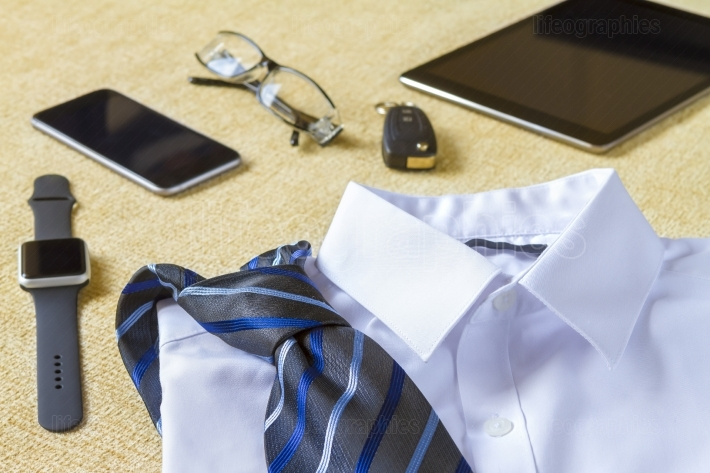 Businessman style clothes and objects concept