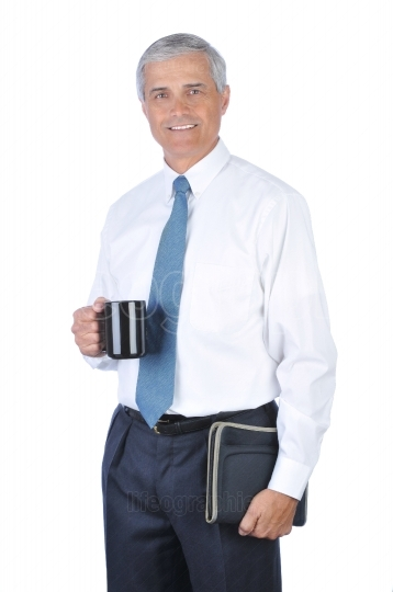 Businessman With Coffee and Notebook