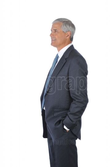 Businessman with hands in pockets profile view