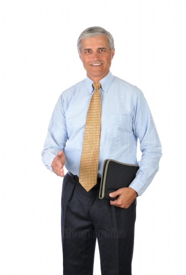 Businessman with notebook and hand extended to shake