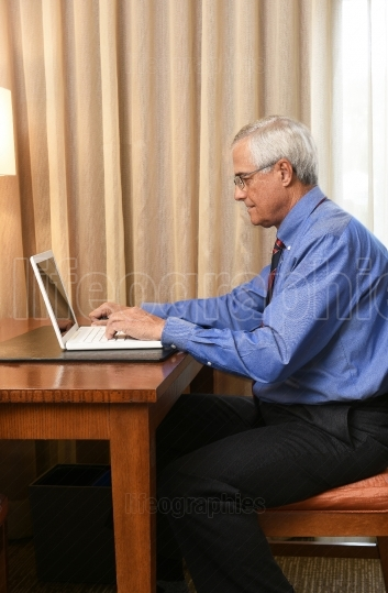 Businessman Working in Hotel Room