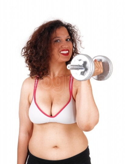 Busty woman with dumbbells.