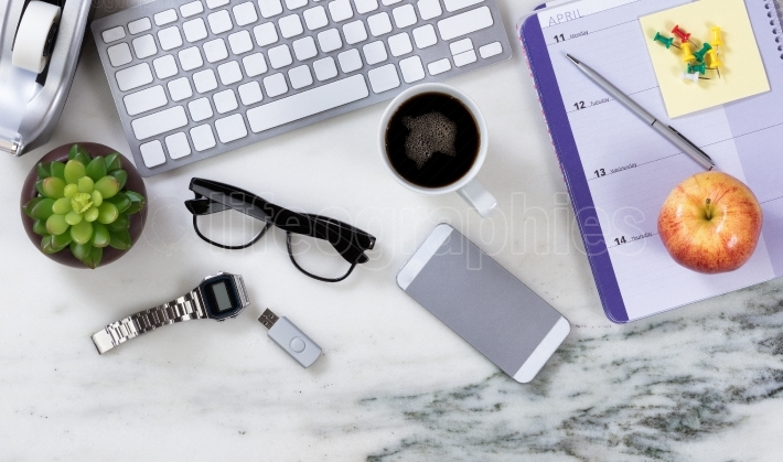 Busy marble desktop surface with various business objects