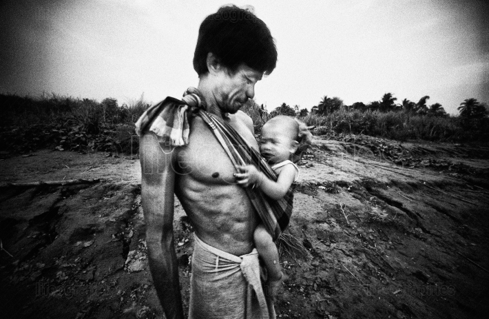 Cambodian man with baby