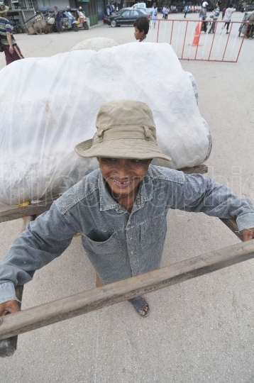 Cambodian worker doing the hard and badly paid work