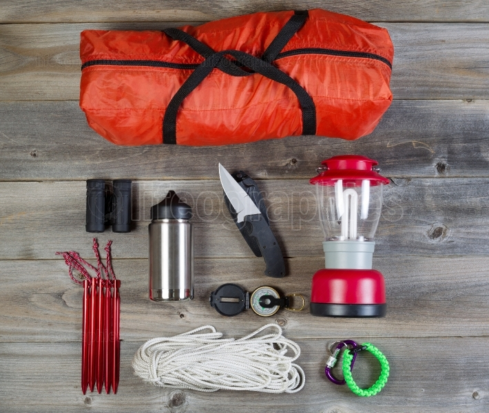 Camping Gear on Rustic Wooden Boards