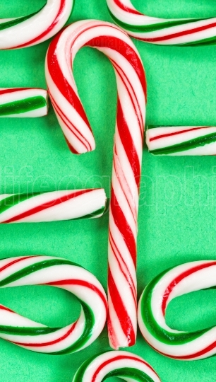 Candy canes joined in a collection on a green background