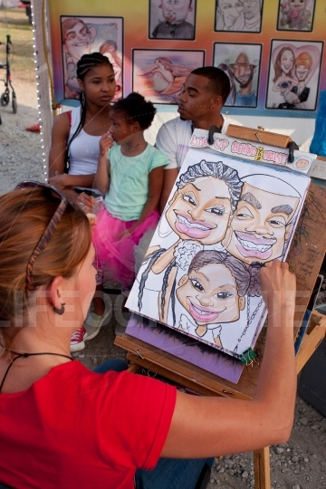Caricature artist draws family portrait at state fair