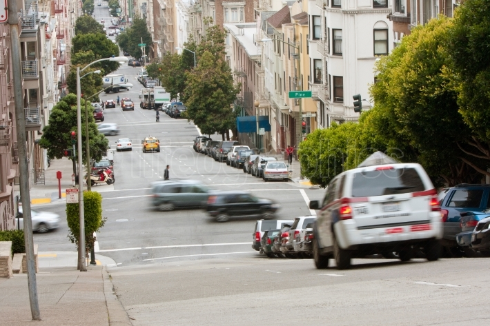 Cars motion blur travelling down hilly san francisco streets