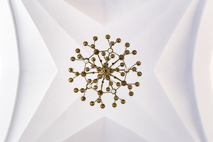 Chandelier on a church ceiling Symmetry, lines and circles