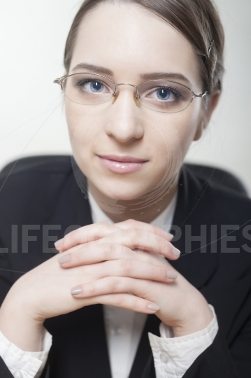 Charming young business woman smiling confidently