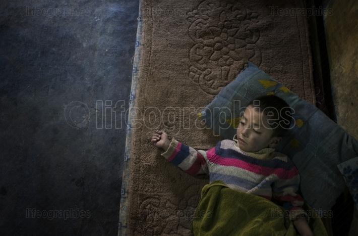 Child sleeps on a mattress in his grandparents